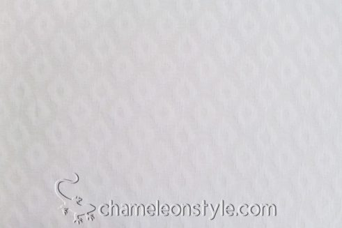 Avan Snowdrop, a white geometric print matelasse